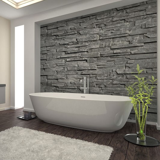 bathtub against a stone wall inlay